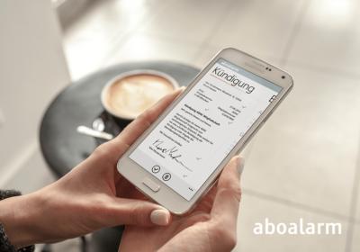 Aboalarm Logo und App auf iPhone