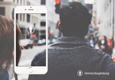 Demenz App auf iPhone Demenz App logo - Szene mit Jungen Mann in voller Altstadt
